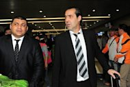 Former Argentina manager Sergio Batista (C) arrives with his assistant coaches in Shanghai on May 25. Batista said Chelsea&#39;s Didier Drogba could soon join him at Shanghai Shenhua as he was unveiled as Chinese football&#39;s latest star acquisition on Wednesday