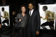 "Cast member Chiwetel Ejiofor (R) poses with actress Jacqueline Bisset at a special screening of ""12 Years a Slave"" at the Directors Guild of America in Los Angeles, California October 14, 2013. REUTERS/Mario Anzuoni"
