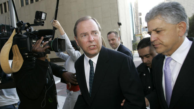 FILE - In this Oct. 23, 2006, file photo former Enron CEO Jeff Skilling, left,  leaves the federal courthouse with his attorney Daniel Petrocelli, right, after being sentenced to 292 months in federal prison. Federal prosecutors and attorneys for Skilling say they have reached an agreement that will reduce the jailed executive's sentence for his role in the energy giant's collapse. Under the agreement, Skilling's original sentence will be reduced to somewhere between 14 and 17.5 years.  (AP Photo/David J. Phillip, File)
