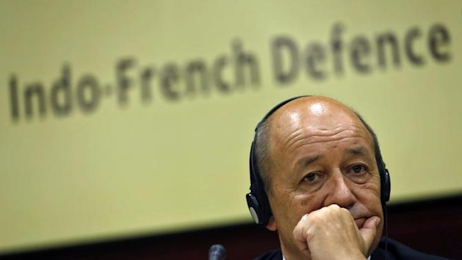 French Defence Minister Le Drian listens to a reporter's question before addressing a gathering at the Institute for Defence Studies and Analyses in New Delhi