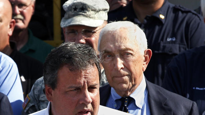 FILE -  In this Aug. 31, 2011 file photograph, Sen. Frank Lautenberg, right, D-N.J., listens as New Jersey Gov. Chris Christie addresses a gathering in Lincoln Park, N.J. Christie faces a significant decision on who should succeed the late Democratic Sen. Frank Lautenberg. For Christie, the choice carries major political implications for his re-election campaign and, perhaps, a future presidential run. Republicans and Democrats alike will be watching Christie's next moves closely. But for the governor with an independent streak, there's no telling what he will do.  (AP Photo/Mel Evans, file)