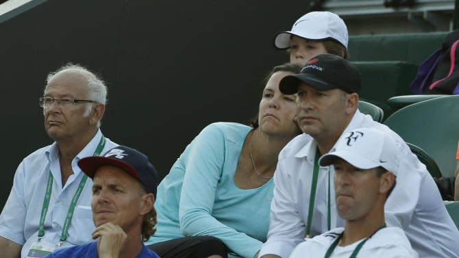 Former Wimbledon champion Lindsay Davenport , centre, watches as Madison Keys of the United States plays Stefanie Voegele of Switzerland during their women's singles first round match at the All England Lawn Tennis Championships in Wimbledon, London, Tuesday June 30, 2015. (  (AP Photo/Alastair Grant)