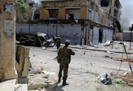Syrian troops clash with rebel fighters in the Izaa (Radio) area in Aleppo on September 3. Fighting for control of a fortress-like position in Aleppo is raging as Russia tries to revive a divisive accord on ending the bloodshed that calls for a government of unity in Syria