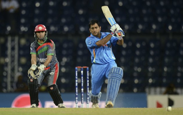 India's Dhoni hits out watched by Afghanistan's Sadiq during ICC World Twenty20 group A match at R Premadasa Stadium, Colombo