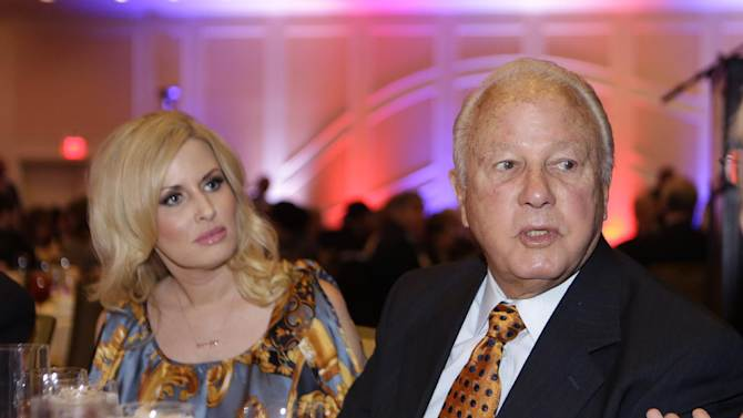 """File -In this Wednesday, Dec. 12, 2012 file photo, Former Louisiana governor Edwin Edwards and his wife Trina Scott Edwards attend a luncheon for a Council For a Better Louisiana in Baton Rouge, La. Edwards and his wife, Trina, get their own reality show starting in February on the A&E cable network. """"The Governor's Wife"""" is a vehicle to showcase Trina, the 30-something wife of the octogenarian ex-con former governor of the Pelican State. (AP Photo/Gerald Herbert, File)"""