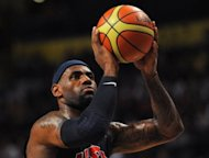 LeBron James of the USA takes a free throw during an Olympic warmup game against Great Britain at the Manchester Arena on July 19. James edges Swiss tennis legend Roger Federer for the title of biggest moneymaker at the London Olympics with an annual income of $53 million, according to Forbes magazine
