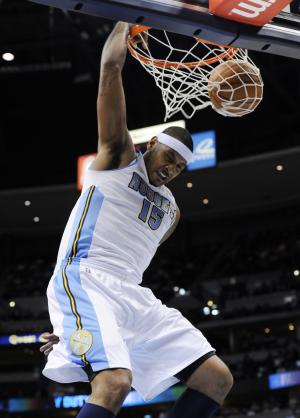 Denver Nuggets forward Carmelo Anthony (15) dunks against the Oklahoma City Thunder during the third quarter of an NBA basketball game Wednesday, Jan. 19, 2011, in Denver. (AP Photo/Jack Dempsey)