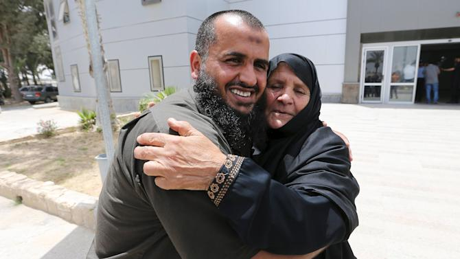 A Palestinian man hugs his mother after she returned to Gaza through the Rafah border crossing between Egypt and southern Gaza Strip