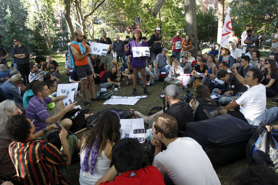 Activist associated with the Occupy Wall Street movement participate in a general assembly during a gathering of the movement in Washington Square park, Saturday, Sept. 15, 2012 in New York. The Occupy Wall Street movement will mark it's first anniversary on Monday.  (AP Photo/Mary Altaffer)