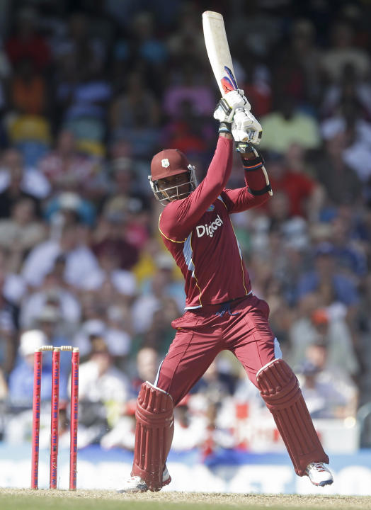 West Indies' Marlon Samuels plays a shot during the first T20 International cricket match against England at the Kensington Oval in Bridgetown, Barbados, Sunday, March 9, 2014. (AP Photo/Ricardo M