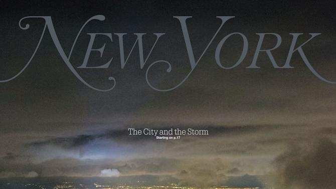 This image provided by New York Magazine shows the magazine's cover released Saturday, Nov. 3, 2012. The cover features a photograph taken by Iwan Baan on Wednesday, Oct, 31, 2012, showing New York City's Manhattan borough, half aglow and half in dark, after Superstorm Sandy slammed into the East Coast and morphed into a huge and problematic system, causing power outages for about 8.5 million. The cost of the storm could exceed $18 billion in New York alone. (AP Photo/New York Magazine, Iwan Baan) MANDATORY CREDIT