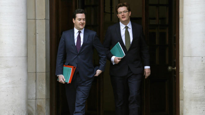 Britain's Chancellor of the Exchequer, George Osborne, left, walks with Chief Secretary to the Treasury, Danny Alexander, to deliver the half-yearly budget statement to parliament in London, Wednesday Dec. 5, 2012. Britain's Treasury chief, George Osborne, unveiled plans to kick-start the U.K.'s moribund economy when he presented his updated budget policies to lawmakers. (AP Photo/Andrew Winning, Pool)