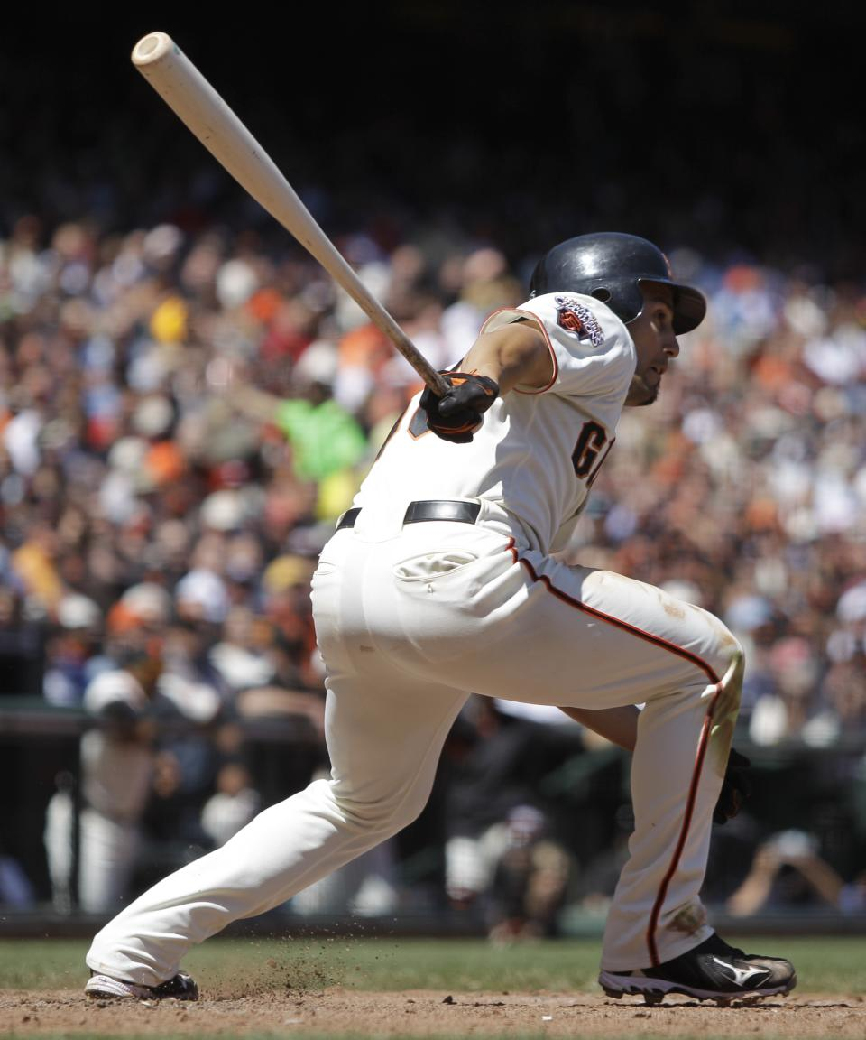 San Francisco Giants' Andres Torres watches his RBI-double off Arizona Diamondbacks' Daniel Hudson during the seventh inning of a baseball game Thursday, May 12, 2011, in San Francisco. (AP Photo/Ben Margot)