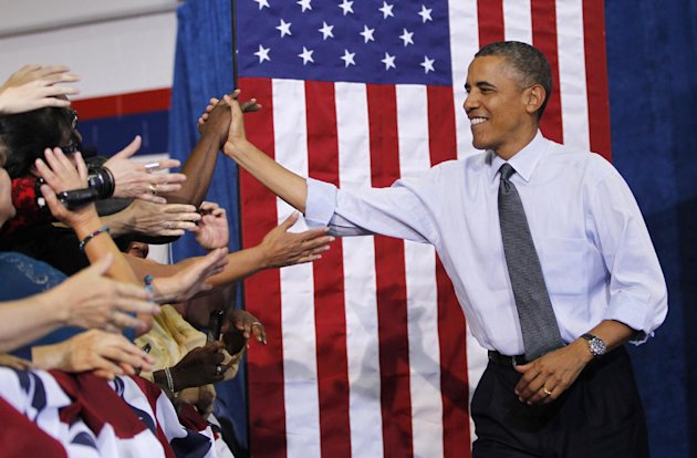 President Barack Obama greets supporters at a campaign event at the University of Colorado Auraria Events Center, Wednesday, Aug. 8, 2012, in Aurora, Colo. (AP Photo/Pablo Martinez Monsivais)