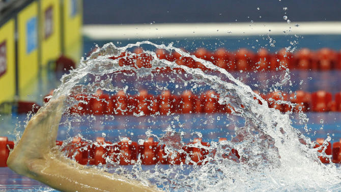 South Africa's Heerden Herman makes a turn during a men's 1,500m Freestyle heat at the FINA Swimming World Championships in Shanghai, China, Saturday, July 30, 2011.  (AP Photo/Wong Maye-E)