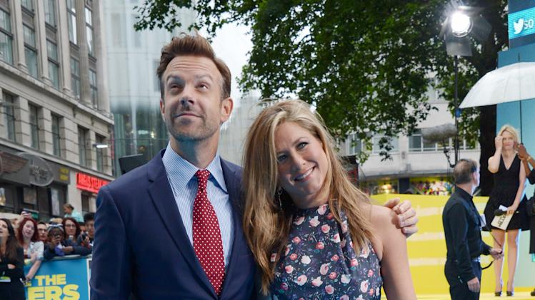 Jason Sudeikis and Jennifer Aniston attend the European Premiere of We're The Millers at Odeon West End in London on Wednesday Aug. 14, 2013. (AP Photo/Jon Furniss/Invision/AP Images)