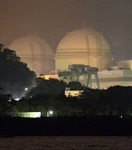 Ohi nuclear power plant is seen after its No. 3 rector, right, returned to operation in Ohi town, Fukui prefecture, western Japan, Sunday, July 1, 2012. The reactor restarted Sunday, the first to go back online since Japan shut down all of its reactors for safety checks following the Fukushima nuclear disaster. (AP Photo/Kyodo News) JAPAN OUT, MANDATORY CREDIT, NO LICENSING IN CHINA, HONG KONG, JAPAN, SOUTH KOREA AND FRANCE