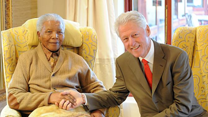 Former US President, Bill Clinton, right, meets with former South African President Nelson Mandela at his home in Qunu, South Africa, Tuesday, July 17, 2012 on the eve of Mandela's 94th birthday.  (AP Photo/Peter Morey) CREDIT MANDATORY. SOUTH AFRICA OUT. NO SALES NO ARCHIVE NO USE AFTER 48 HOURS AFTER TRANSMISSION