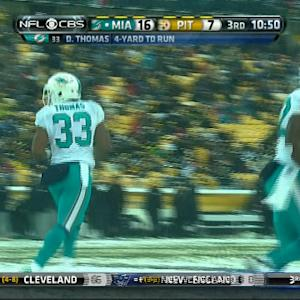 Miami Dolphins running back Daniel Thomas walks into the end zone