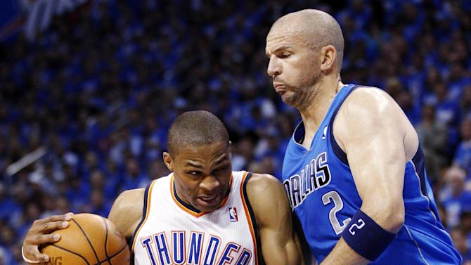 Oklahoma City Thunder guard Russell Westbrook (0) drives around Dallas Mavericks guard Jason Kidd (2) in the first quarter of Game 1 in a first-round NBA basketball playoff series in Oklahoma City, Saturday, April 28, 2012. (AP Photo/Sue Ogrocki)