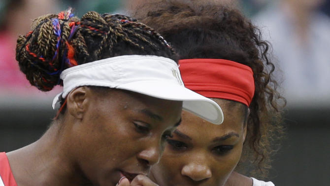 Venus Williams, left, and Serena Williams of the United States confer as they compete against Andrea Hlavackova and Lucie Hradecka of the Czech Republic during the gold medal women's doubles match at the All England Lawn Tennis Club in Wimbledon, London at the 2012 Summer Olympics, Sunday, Aug. 5, 2012. (AP Photo/Elise Amendola)