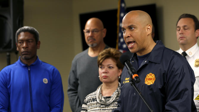 "FILE- In this Monday, Oct. 29, 2012, file photo, Newark Mayor Cory Booker, right, talks during a news conference at the Office of Emergency Management in preparation for the arrival of Hurricane Sandy, in Newark, N.J. Booker said Sunday, Dec. 9, 2012, that he'll decide within two weeks whether to challenge Republican Gov. Chris Christie next year. Booker, who leads the state's largest city, also told CBS' ""Face the Nation"" that he's also thinking about running for the U.S. Senate. (AP Photo/Julio Cortez, File)"