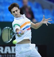 French Edouard Roger-Vasselin returns a ball to Ukrainian Alexander Dolgopolov during the Kremlin Cup tennis tournament match in Moscow. Roger-Vasselin, 116th in the ATP rankings, advanced into the quarter-finals with a 6-3, 5-7, 7-6 (8/6) win