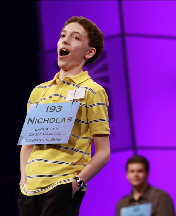 Nicholas Rushlow, 14, of Pickerington, Ohio, reacts after spelling a word correctly during the sixth round of the semifinals at the National Spelling Bee, Thursday, May 31, 2012, in Oxon Hill, Md., ma