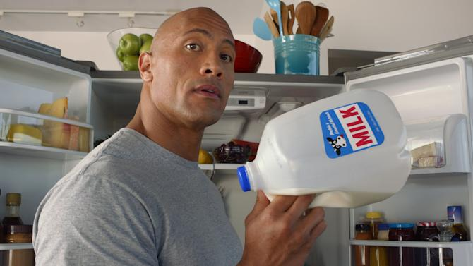 "This undated screenshot provided by the Milk Processor Education Program, known as MilkPep shows the company's Super Bowl advertisement. The Milk Processor Education Program, known as MilkPep and popular for its ""Got Milk?"" print ads, is featuring actor and professional wrestler Dwayne ""The Rock"" Johnson in a 30-second ad in the second quarter that is directed by Peter Berg. (AP Photo/Milk Processor Education Program)"