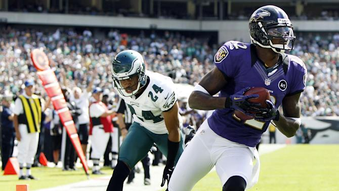 Baltimore Ravens wide receiver Jacoby Jones, right, scores a touchdown past Philadelphia Eagles cornerback Nnamdi Asomugha in the first half of an NFL football game, Sunday, Sept. 16, 2012, in Philadelphia. (AP Photo/Mel Evans)
