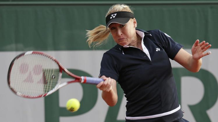 File photograph shows Baltacha of Britain hitting a return to Erakovic of New Zealand during their women's singles match at the French Open tennis tournament in Paris