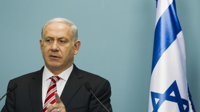 "Israel's Prime Minister Benjamin Netanyahu gives a statement in front the media at the Prime Minister's office in Saturday, Sept. 10, 2011 in Jerusalem. The storming of the Israeli embassy by a mob of Egyptian protesters inflicted a ""severe injury to the fabric of peace"" between the two countries, Netanyahu warned on Saturday, as both sides' leadership tried to contain the worst crisis in ties since their 1979 peace treaty. (AP Photo/Bernat Armangue)"