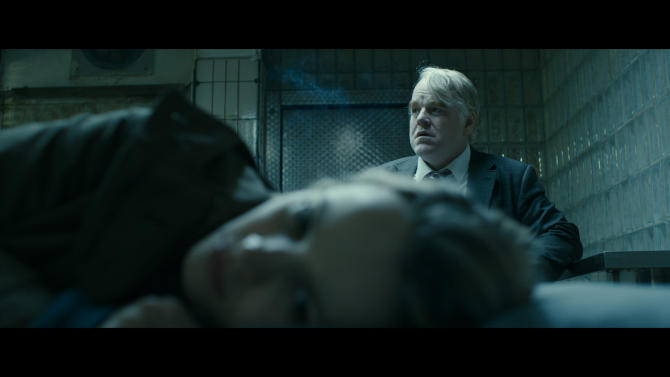 """This photo provided courtesy of the Sundance Institute shows Philip Seymour Hoffman, rear, and Rachel McAdams, in the film, """"A Most Wanted Man,"""" directed by Anton Corbijn. The film stars Hoffman, Rachel McAdams, Willem Dafoe and Robin Wright, and is a modern-day thriller based on a John le Carre bestseller. The film premieres at the 2014 Sundance Film Festival, which runs Jan. 16 - 26, 2014, in Park City, Utah. (AP Photo/Sundance Institute)"""