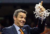 GREENSBORO, NC - MARCH 16: Virginia Cavaliers head coach Tony Bennett smiles after he cut down the net after they beat the Duke Blue Devils in the finals of the 2014 Men's ACC Basketball Tournament at Greensboro Coliseum on March 16, 2014 in Greensboro, North Carolina. (Photo by Streeter Lecka/Getty Images)