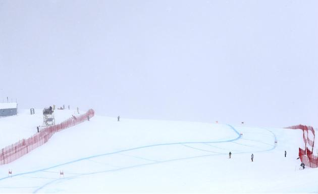 The men's alpine skiing World Cup downhill race course is shrouded in fog, in St. Moritz, Switzerland, Saturday, Feb. 1, 2014. Fog prevented downhill racers from getting their Olympic dress rehear