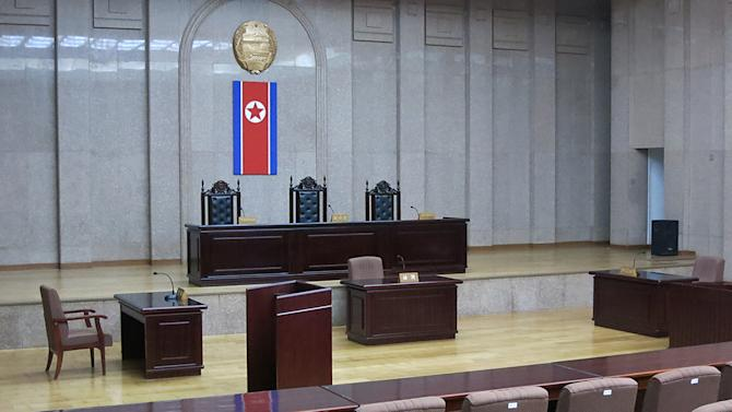 In this March 20, 2013 photo, a North Korean flag hangs inside the interior of Pyongyang's Supreme Court.   North Korea says it will soon deliver a verdict in the case of detained American Kenneth Bae it accuses of trying to overthrow the government, further complicating already fraught relations between Pyongyang and Washington. The announcement about Bae comes in the middle of a lull after weeks of war threats and other provocative acts by North Korea against the U.S. and South Korea.  Bae, identified in North Korean state media by his Korean name, Pae Jun Ho, is a tour operator of Korean descent who was arrested after arriving with a tour on Nov. 3 in Rason, a special economic zone bordering China and Russia. (AP Photo)