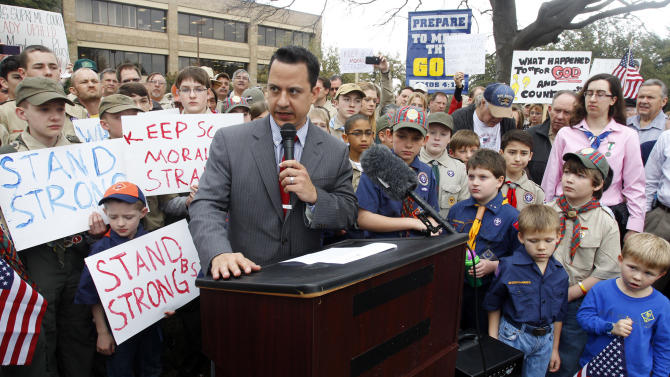 "Surrounded by area scouts, Jonathan Saenz, president of Texas Values, reads the press release to that crowd announcing that the Boy Scouts of America will be postponing its decision to admit gays at the ""Save Our Scouts"" Prayer Vigil and Rally in front of the Boy Scouts of America National Headquarters in Irving, Texas, Wednesday, February 6, 2013. (AP Photo/Richard Rodriguez)"
