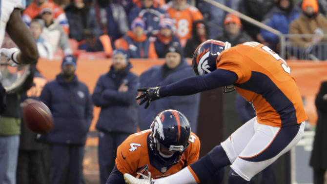 Denver Broncos kicker Matt Prater, right, kicks a 64-yard field goal as Britton Colquitt holds during the first half of an NFL football game against the Tennessee Titans on Sunday, Dec. 8, 2013, in Denver. (AP Photo/Jack Dempsey)