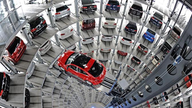 FILE - In this March 3, 2012 photo, a lift brings a Volkswagen Beetle from a tower at the Autostadt in Wolfsburg, Germany. A steadily improving economy and strong December sales lifted the American auto industry to its best performance in five years in 2012, especially for Volkswagen and Japanese-brand vehicles, and experts say the next year should be even better. (AP Photo/dapd, David Hecker, File)