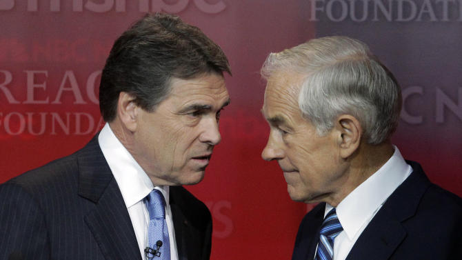 Republican presidential candidates Texas Gov. Rick Perry, left, and Rep. Ron Paul, R-Texas, talk before the start of the Republican presidential candidate debate at the Reagan Library Wednesday, Sept. 7, 2011, in Simi Valley, Calif.  (AP Photo/Jae C. Hong)