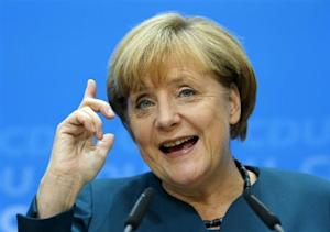 German Chancellor Merkel gestures during news conference after CDU party board meeting in Berlin