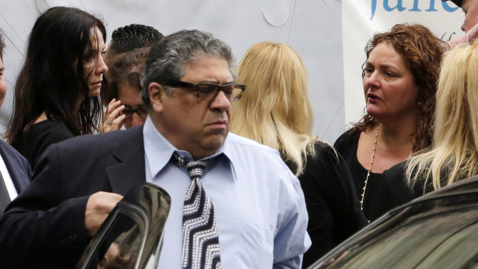 """Actor Vincent Pastore and actress Aida Turturro, right, arrive for the funeral service of James Gandolfini, star of """"The Sopranos,"""" in New York's the Cathedral Church of Saint John the Divine, Thursday, June 27, 2013. The 51-year-old actor died of a heart attack last week while vacationing in Italy with his son.(AP Photo/Richard Drew)"""