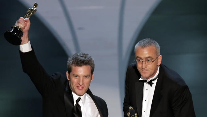 "FILE - In this March 5, 2006 file photo, Mike Hopkins, right, and Ethan Van der Ryn accept the Oscar for achievement in sound editing for their work on ""King Kong"" at the 78th Academy Awards in Los Angeles. Oscar-winning sound editor Mike Hopkins, who worked on the ""Lord of the Rings"" trilogy and other blockbusters, has died in a rafting accident in New Zealand. Police Senior Sergeant Carolyn Watson said the 53-year-old Hopkins drowned on Sunday, Dec. 30, 2012 after his raft capsized in a river on New Zealand's North Island. (AP Photo/Mark J. Terrill, File)"