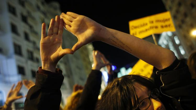 A demonstrator gestures during a pro-choice protest against the proposed new abortion law in Madrid