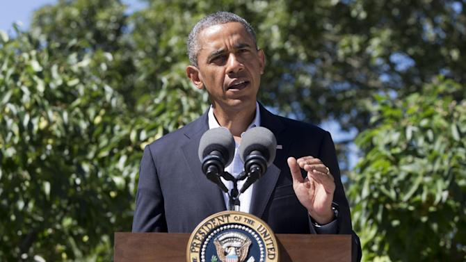 President Barack Obama makes a statement to the media regarding events in Egypt, from his rental vacation home in Chilmark Mass., on the island of Martha's Vineyard, Thursday, Aug. 15, 2013. The president announced that the US is canceling joint military exercise with Egypt amid violence. (AP Photo/Jacquelyn Martin)