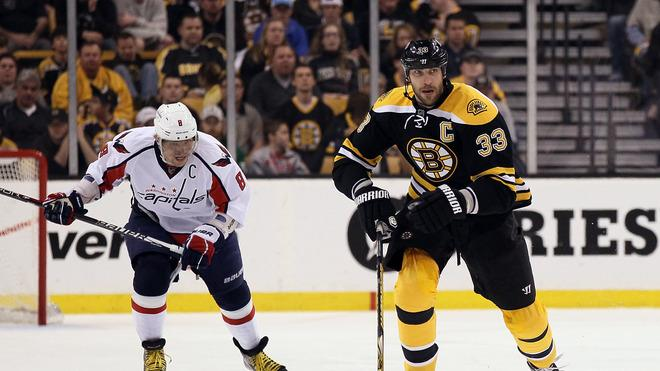Zdeno Chara #33 Of The Boston Bruins Takes The Puck As Alex Ovechkin #8 Of The Washington Capitals Defends In Game Getty Images