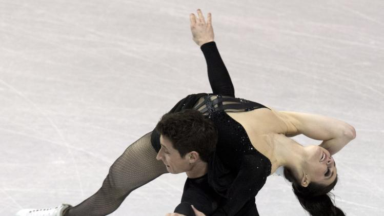 Tessa Virtue and Scott Moir, of Canada, perform their free dance in the ice dance competition at the World Figure Skating Championships, Saturday, March 16, 2013, in London, Ontario. (AP Photo/The Canadian Press, Frank Gunn)