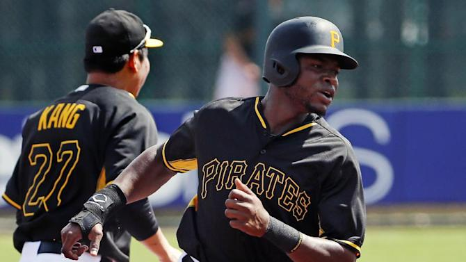 Pittsburgh Pirates' Gregory Polanco rounds second during the first inning of an intrasquad spring training baseball game in Bradenton, Fla., Monday, March 2, 2015.  (AP Photo/Gene J. Puskar)