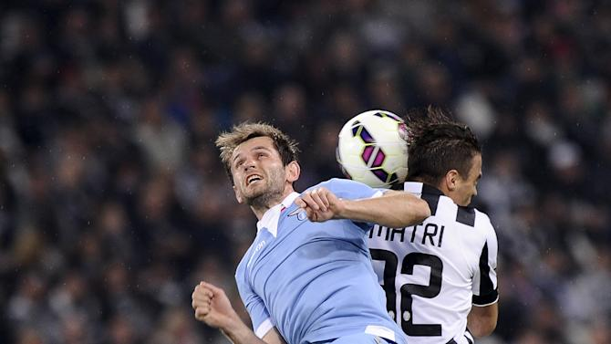 Juventus' Alessandro Matri fights for an aerial ball with Lazio's Senad Lulic during their Italian Serie A soccer match in Turin