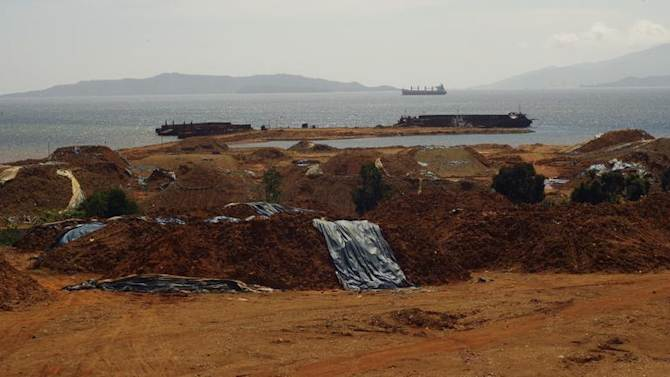 Stockpiles of nickel ore are seen awaiting shipment to the port in Pomala, Southeast Sulawesi province